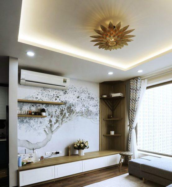 Phòng khách chung cư ấn tượng hơn với đèn trần trang trí hình hoa hướng dương